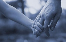 A child and parent holding hands